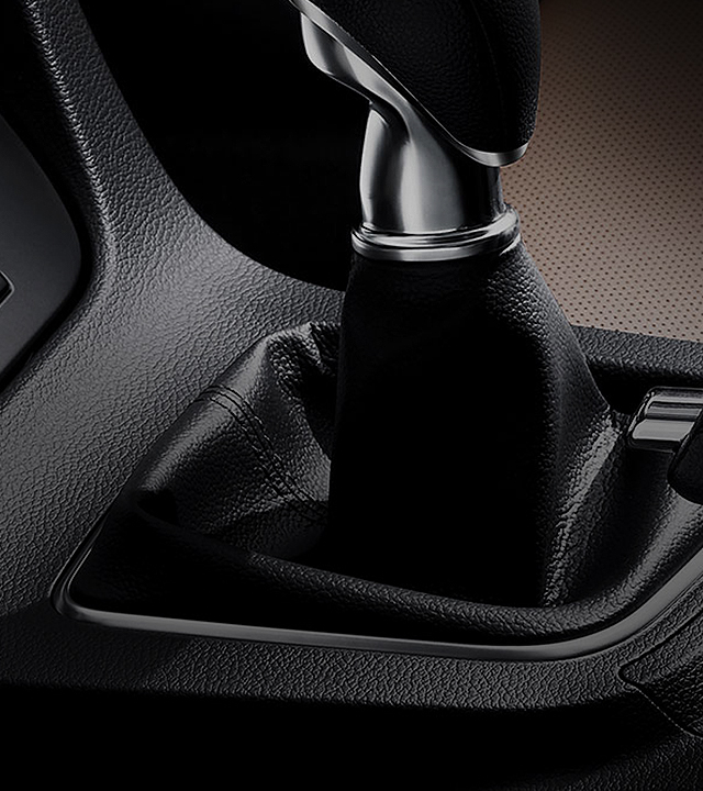 Interior view of Hyundai car closing up at the gear shift