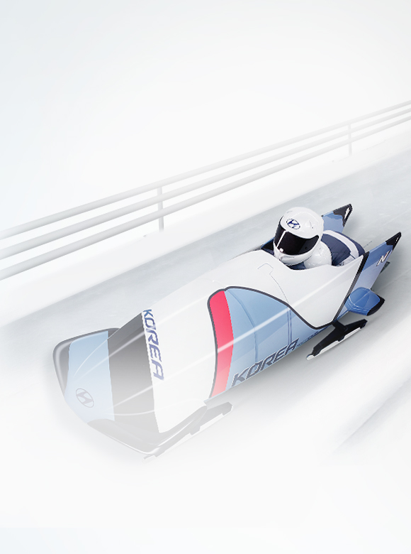 A bobsleigh is sliding down the ice road