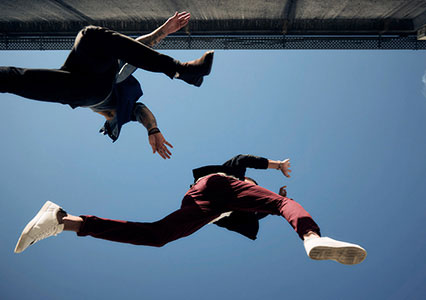Image of two people jumping from below