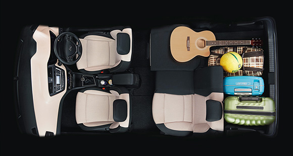 Sky view of interior with many luggage and guitar stored at the back