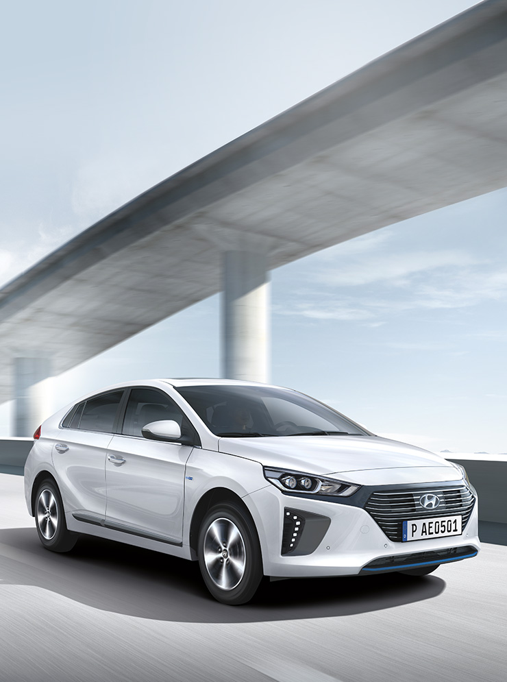 White Ioniq plug-in Hybrid is driving on the road under the bridge