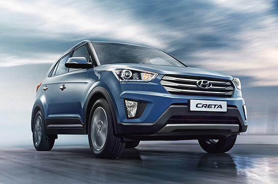 Side front view of navy Creta