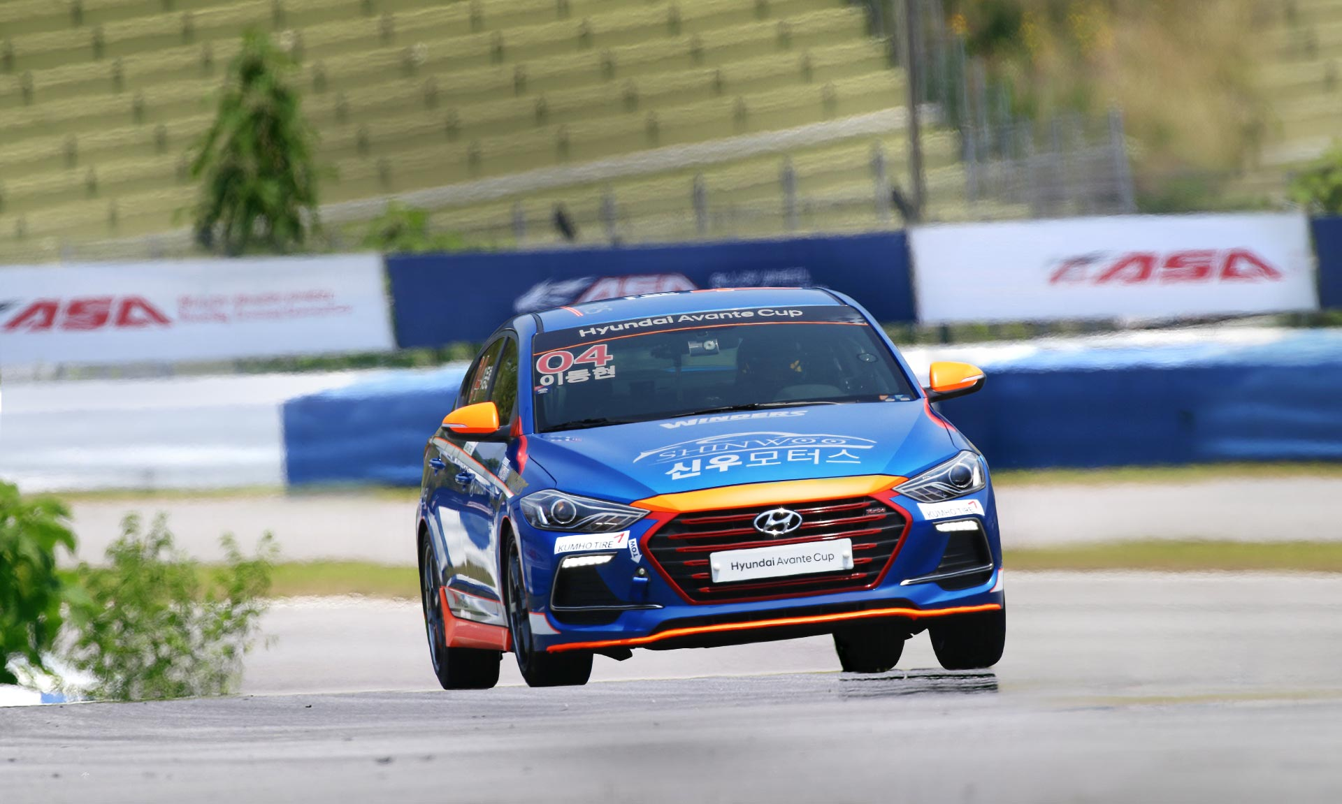 front view of blue and orange racing car on track