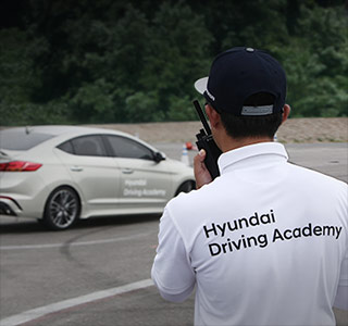 an instructor trains a participant to do drive