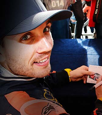 nicolas gilsoul is signing on his name card in the world rally championship