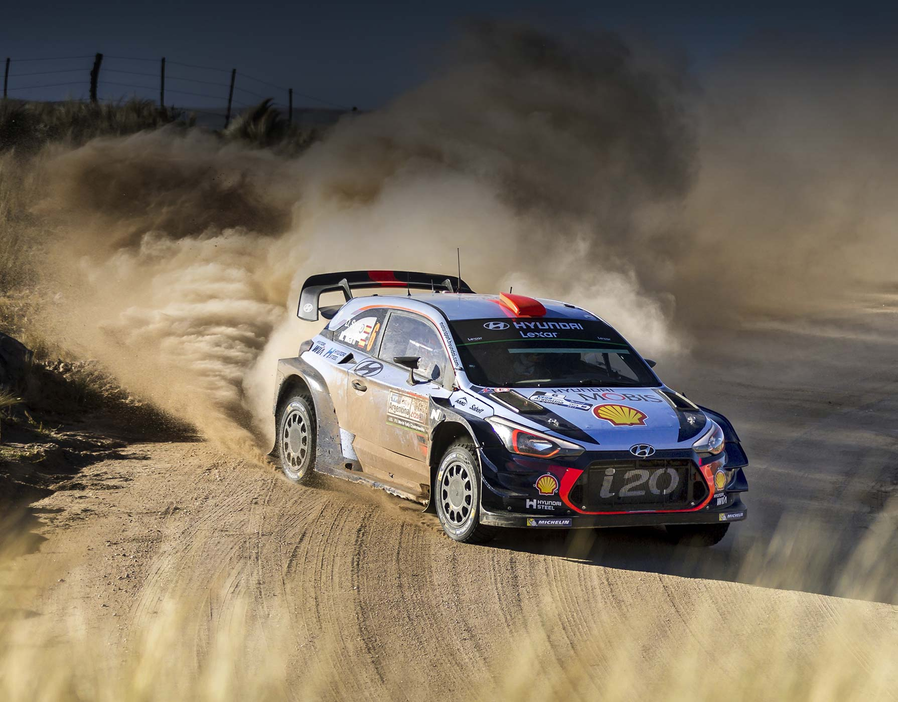 right side front view of i20 on the racing track of the world rally with sandstorm